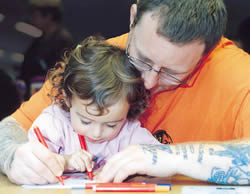 Father and daughter learning to write
