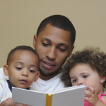Dad reading with his children