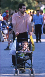 Father pushing a buggy